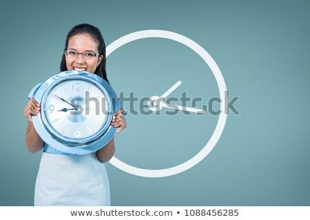 Ravi femme d'affaires horloge blanche espace Photo stock © wavebreak_media