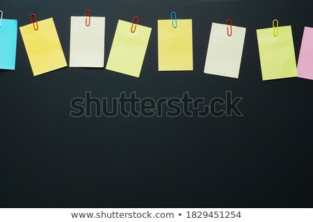 Neon yellow paper note with a blue clip Stock photo © Len44ik