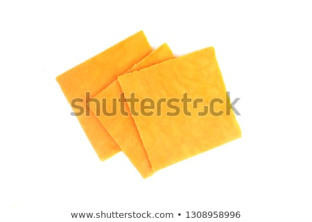 cheddar cheese slices on white background Stock photo © ozaiachin