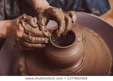 Kezek dolgozik cserépedények kerék közelkép nő Stock fotó © meinzahn
