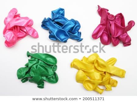 pile of uninflated balloons stock photo © deyangeorgiev