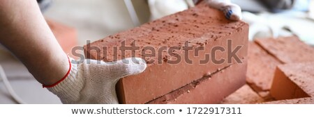 Cement block craftsman in the hands Stock photo © photography33
