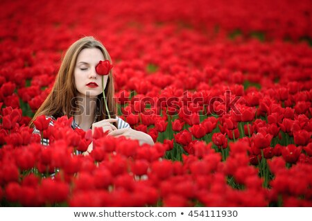 adult woman in red tulip field Stock photo © compuinfoto