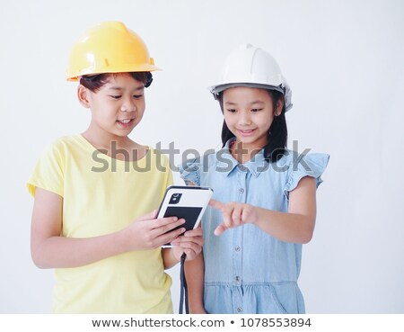 Two kids playing at being construction workers. Stock photo © photography33