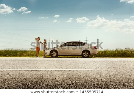 Stock photo: Woman with car broke down