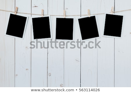 Stock photo: photo paper attach to rope on wooden background