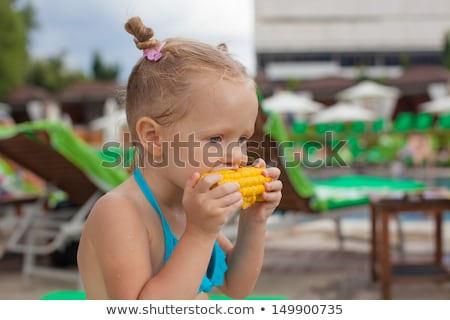 Little girl eating by herself a nutritious snack Stock photo © mlyman