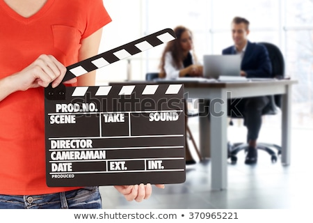 Business man holding a clapboard Stock photo © iko