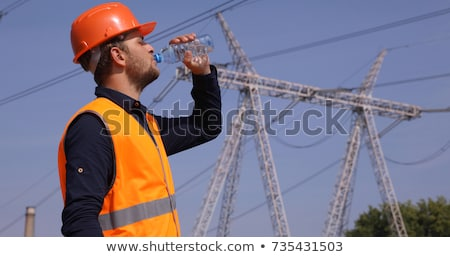 man with a towerl drinking a water stock photo © deandrobot