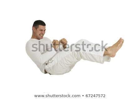 Man dressed in white sitting on the ground makes the abdominal Stock photo © ambro