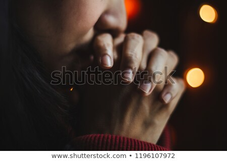 Concerned thoughtful woman praying hands Stock photo © roboriginal