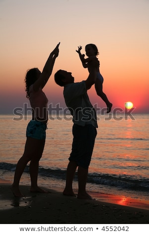 Mummy with daughter and grandfather on sunset ashore Stock photo © Paha_L