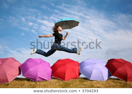 young woman jumps with the umbrella above the umbrellas Stock photo © Paha_L