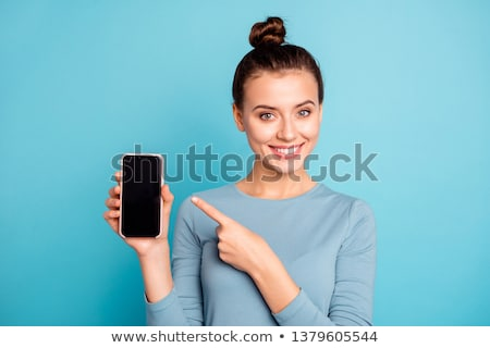 Woman pointing up with her forefinger. Stock photo © RAStudio
