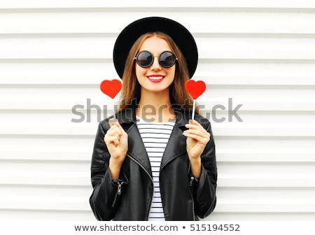 lovely woman in sunglasses holding candy stock photo © deandrobot