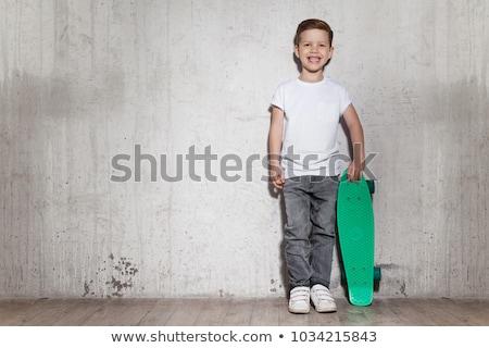 Jungen Skateboarder stehen skate Straße Straße Stock foto © OleksandrO