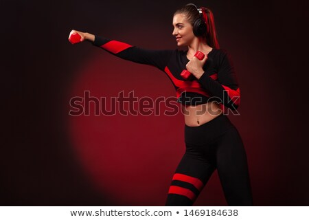 Fit girl with red headphones. Stock photo © NeonShot