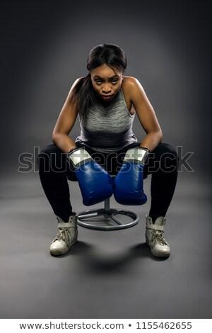Determined woman wearing boxing gloves Stock photo © wavebreak_media