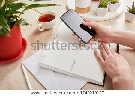 Bureau fournir table en bois enveloppe connexion Photo stock © wavebreak_media