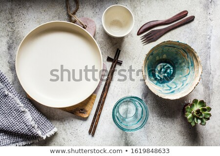 Empty ceramic bowl on wooden kitchen board Stock photo © BSANI