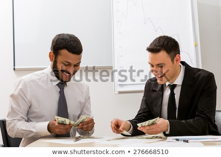 Colleagues counting money Stock photo © IS2