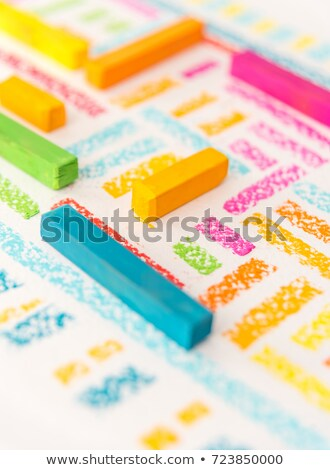 Cropped photo of drawing lines by blue pastel chalks Stock photo © deandrobot