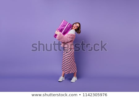 Full length image of Pleased young girl holding gift box Stock photo © deandrobot