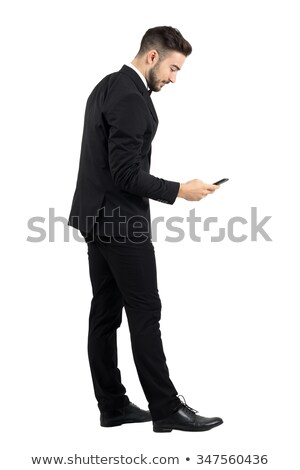 side view of a fashion model in tuxedo holding  bowtie  Stock photo © feedough