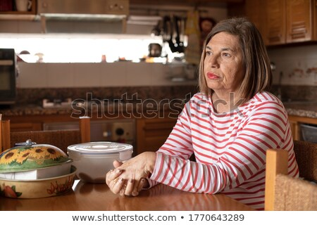 Senior woman drinking a cup of tea Stock photo © FreeProd