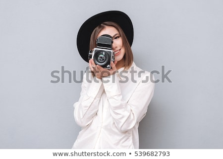 Woman using a video camera Stock photo © IS2