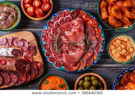 Bowl of chorizo on wooden table Stock photo © IS2