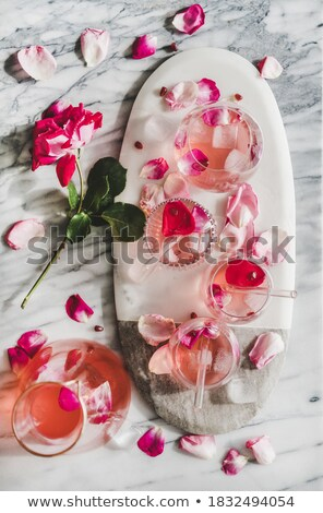 clean cold ice cubes on a gray marble background ingredient for summer cooling drink flat lay stock photo © artjazz