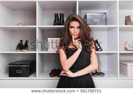 Pensive brunette wearing white dress Stock photo © acidgrey