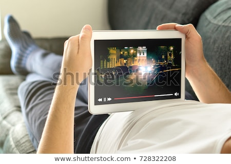 Man Using Digital Tablet For Watching Television Stock photo © AndreyPopov