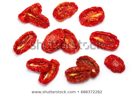 Sundried tomato halves, paths, top view Stock photo © maxsol7