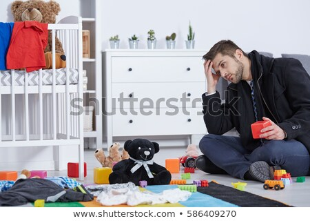 Businessman talking with a teddy bear Stock photo © Minervastock