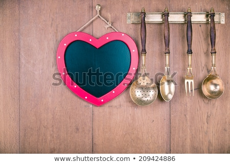 Cook with kitchen tools and empty wallpaper Stock photo © ra2studio