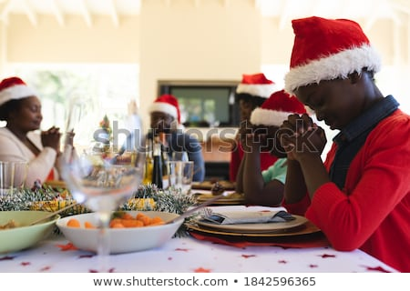 family praying before meal at christmas dinner Stock photo © dolgachov