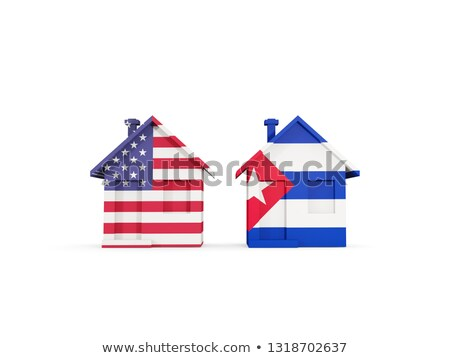 Two houses with flags of United States and cuba Stock photo © MikhailMishchenko