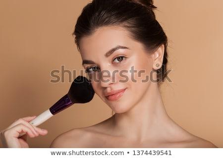 Fille poudre visage isolé blanche Photo stock © svetography