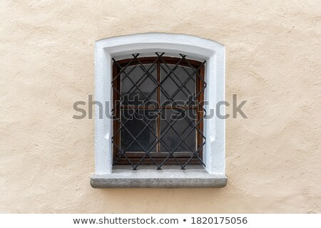 Old Stone Wall With Small Iron Barred Prison Cell Window Stock photo © feverpitch