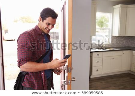 Man coming out of cellphone door Stock photo © jossdiim