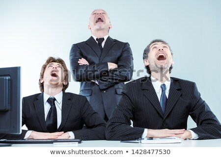 Three businessmen laughing or gawping Stock photo © Giulio_Fornasar