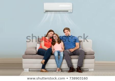 Casal sessão sofá ar condicionado feliz Foto stock © AndreyPopov