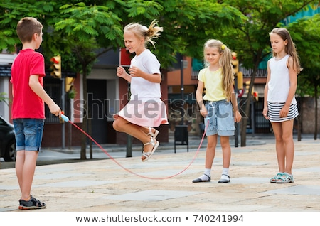 cheerful school age child play on playground school ストックフォト © Lopolo