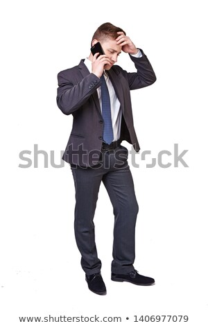 Angry businessman with phone isolated on white Stock photo © Elnur