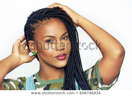Attractive young woman with long hair in braids Stock photo © Giulio_Fornasar