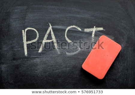 hand erasing past word from blackboard stock photo © andreypopov