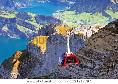 Mount Pilatus aerial cabelway above cliffs and Lake Lucerne land Stock photo © xbrchx
