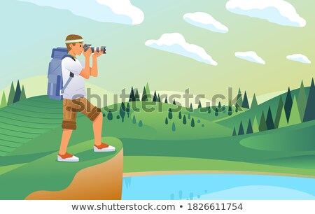 photographer man in autumn taking pictures vector stock photo © robuart